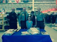 Officer group shot after shopping with kids