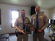 Photos of Sheriffs receiving reward
