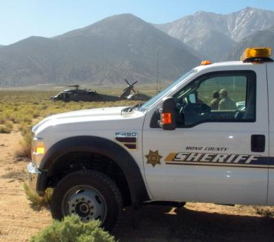 Mutual Aid Search for a Missing Hiker on Boundary Peak