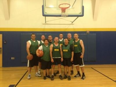 Cops and kids on basketball court